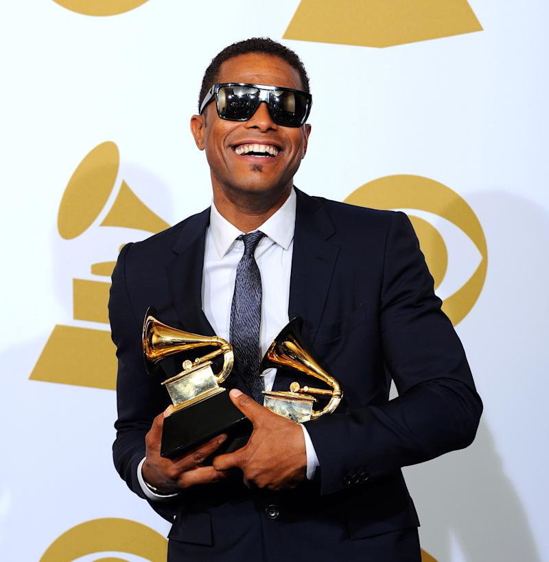 "FILE-  In this Jan. 31, 2010 file photo, Maxwell stands backstage at the Grammy Awards in Los Angeles.  Maxwell may have canceled his 2012 six-date, three-city U.S. tour because of vocal hemorrhaging and swelling, but he's still hard at work on his upcoming album, ""blackSUMMERS' night"" due out this year. (AP Photo/Mark J. Terrill, File)"