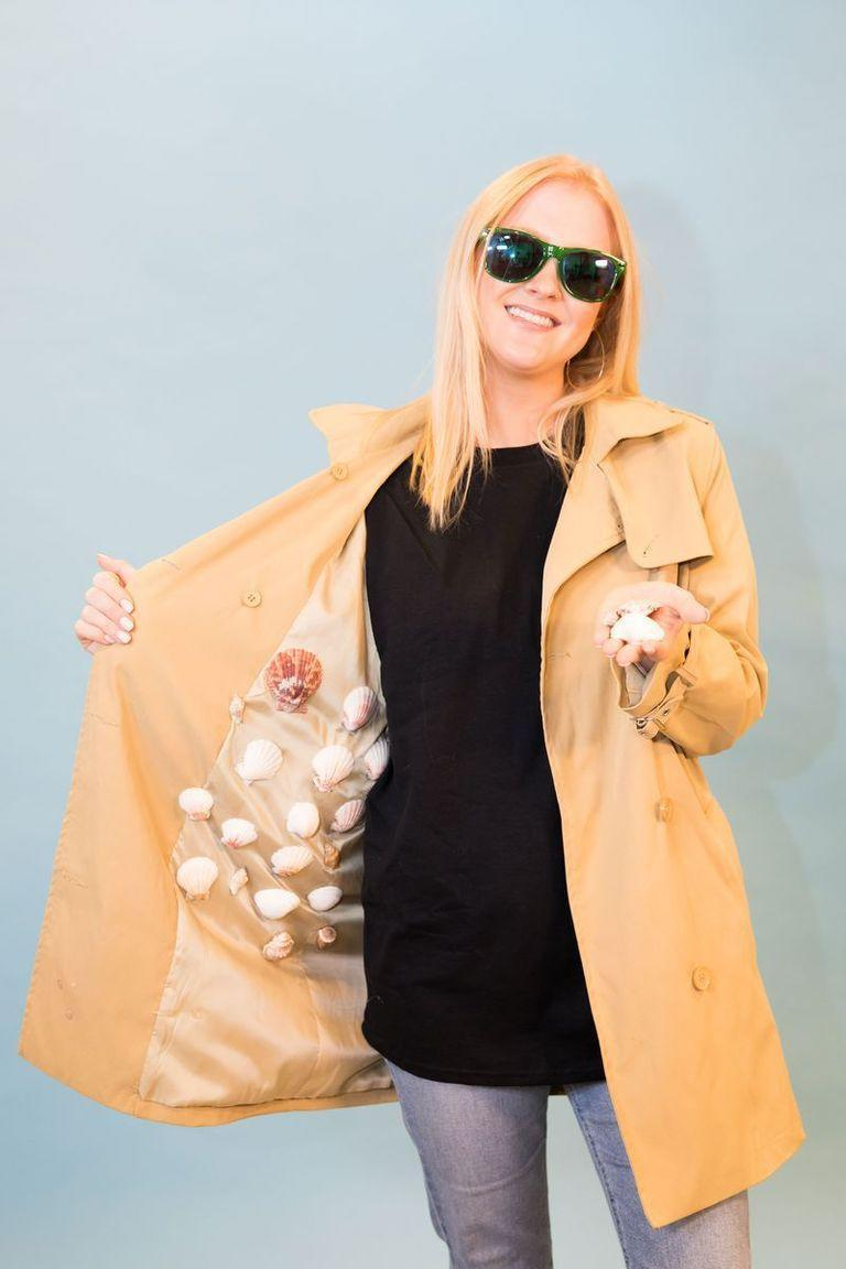 """<p>To take on this tongue twister of a costume, wear a trench coat with clear pockets you can fill with shells along with a pair of dark sunglasses. </p><p><a class=""""link rapid-noclick-resp"""" href=""""https://www.amazon.com/Super-Outlet-Seashells-Decorations-Collection/dp/B07G4G2D19?tag=syn-yahoo-20&ascsubtag=%5Bartid%7C10070.g.490%5Bsrc%7Cyahoo-us"""" rel=""""nofollow noopener"""" target=""""_blank"""" data-ylk=""""slk:SHOP SHELLS"""">SHOP SHELLS</a></p>"""