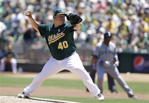 Oakland Athletics starting pitcher Bartolo Colon throws against the Seattle Mariners in the first inning of their baseball game Sunday, June 16, 2013 in Oakland, Calif. (AP Photo/Eric Risberg)