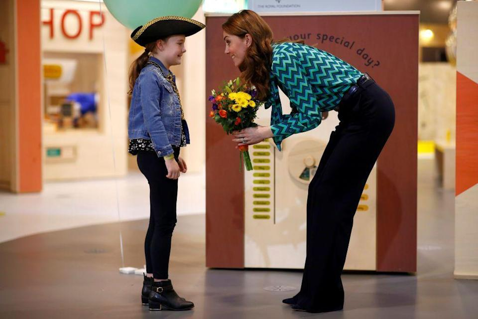 <p>The Duchess of Cambridge plays with a child as she visits MiniBrum, an interactive, child-sized world at Thinktank at Birmingham Science Museum. She chevron pussy-bow blouse by Tabitha Webb. </p>