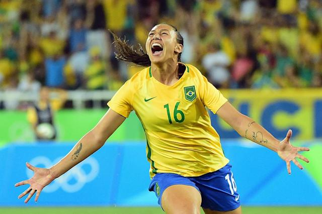 <p>Beatriz of Brazil celebrates her goal during the Women's Group E first round match between Brazil and Sweden on Day 1 of the Rio 2016 Olympic Games at the Olympic Stadium on August 6, 2016 in Rio de Janeiro, Brazil. (Photo by Harry How/Getty Images) </p>