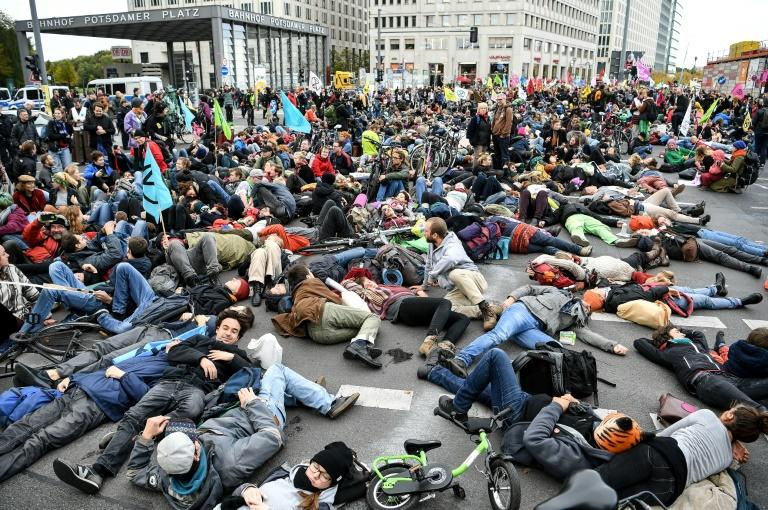 "Activists from the ""Extinction Rebellion"" members demonstrate at Potsdamer Platz square in Berlin"