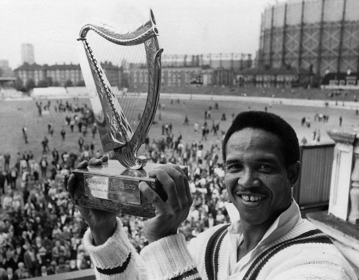 18th August 1970:  The captain of the Rest of the World Cricket team Gary Sobers with the Guinness Trophy, after his team beat England at the Final Test match held at the Oval.  (Photo by Central Press/Getty Images)
