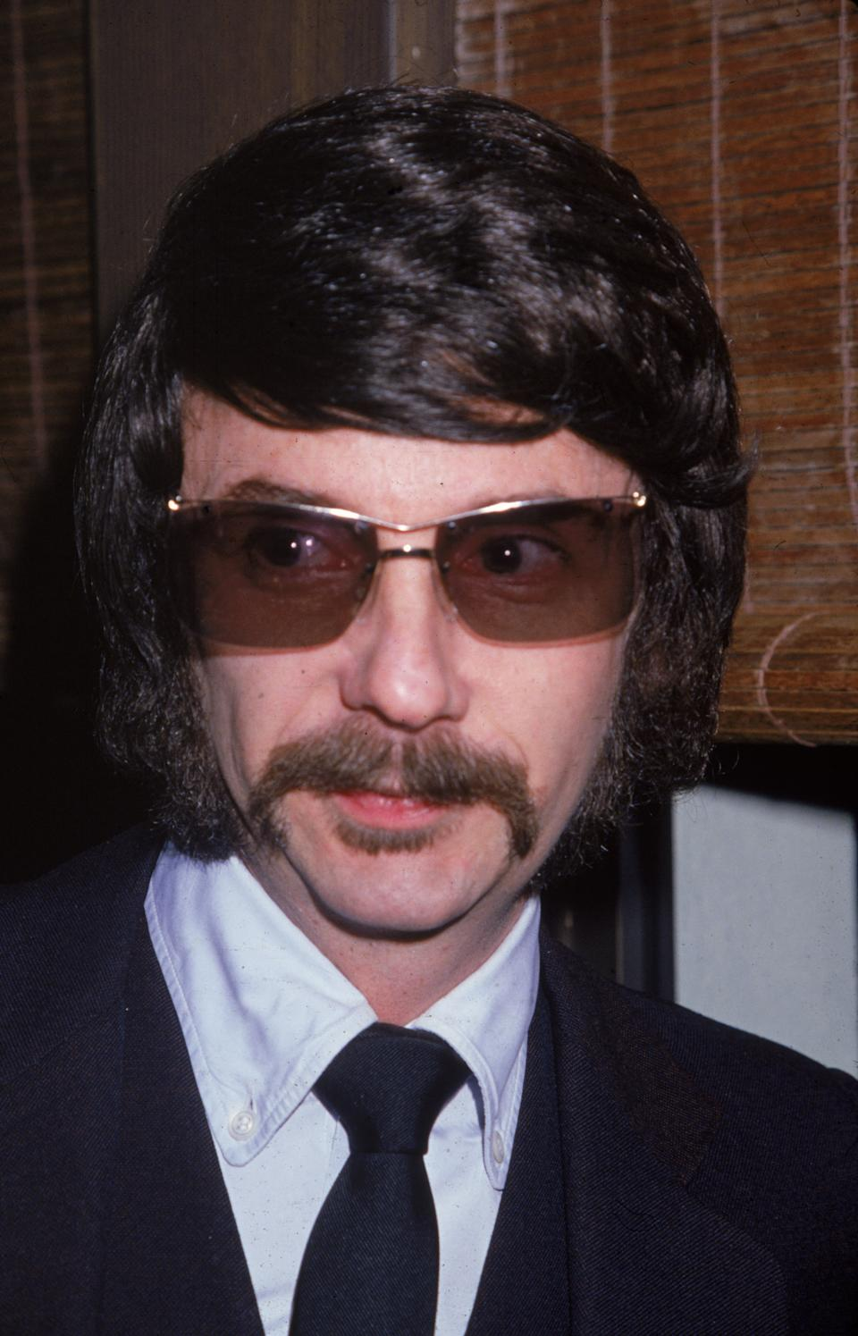 Headshot of American music producer Phil Spector wearing sunglasses indoors, 1980. (Photo by Frank Edwards/Fotos International/Getty Images)