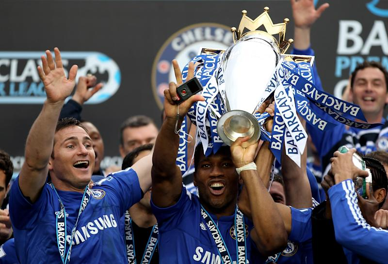 LONDON, ENGLAND - MAY 09: (L to R) Chelsea's Frank Lampard and Didier Drogba celebrate with the trophy after winning the league with an 8-0 victory during the Barclays Premier League match between Chelsea and Wigan Athletic at Stamford Bridge on May 9, 2010 in London, England. (Photo by Chelsea FC/Chelsea FC via Getty Images)