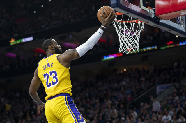 Los Angeles Lakers' LeBron James goes up for the shot during the first half of an NBA basketball game against the Philadelphia 76ers, Saturday, Jan. 25, 2020, in Philadelphia. (AP Photo/Chris Szagola)