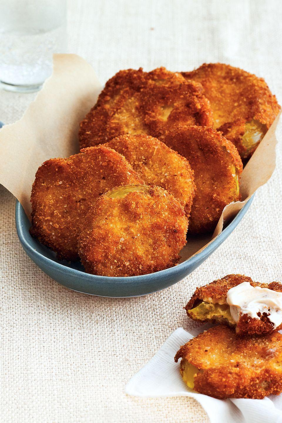 "<p>Similar to the classic fried green tomatoes you love, these juicy bites are kicked up a notch with a cumin-laced dip.</p><p><strong><a href=""https://www.countryliving.com/food-drinks/recipes/a4262/fried-tomatillos-creamy-cumin-dip-recipe-clx1013/"" rel=""nofollow noopener"" target=""_blank"" data-ylk=""slk:Get the recipe"" class=""link rapid-noclick-resp"">Get the recipe</a>.</strong></p>"