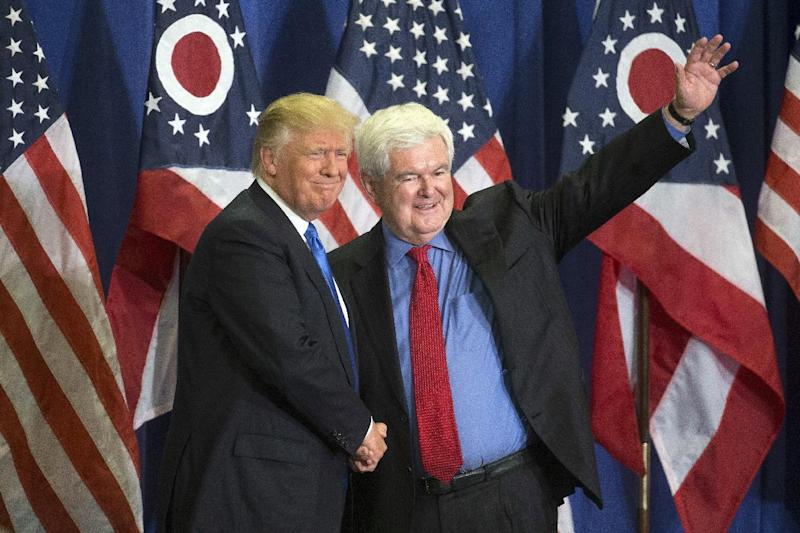 Republican presidential candidate Donald Trump, left, and former House Speaker Newt Gingrich, right, acknowledge the crowd during a campaign rally at the Sharonville Convention Center, Wednesday, July 6, 2016, in Cincinnati. (Photo: John Minchillo/AP)