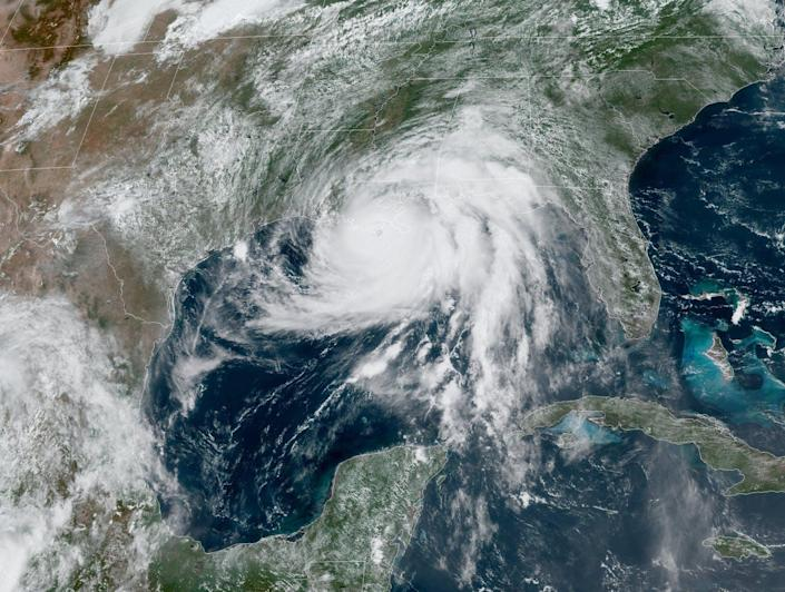 A satellite view of the hurricane over the Gulf of Mexico and coast.