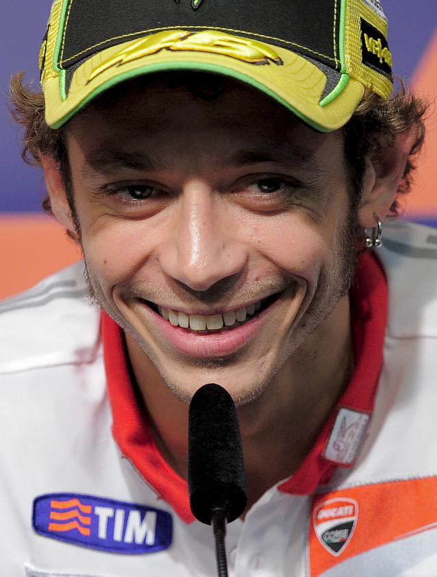 Ducati Team's Italian rider Valentino Rossi smiles during a press conference at the Catalunya racetrack in Montmelo, near Barcelona, on May 31, 2012, on eve of the Catalunya Moto GP Grand Prix training sessions. AFP PHOTO / JOSEP LAGOJOSEP LAGO/AFP/GettyImages