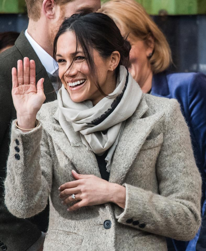 <p>Meghan looked happy as punch during her first official engagement with Prince Harry at Reprezent 107.3FM in London. However her flyaway, messy bun caused quite the stiry amongst royal watchers. According to <i>Insider</i> magazine, it's against royal tradition to have hair in a messy up-do. Photo: Getty Images </p>