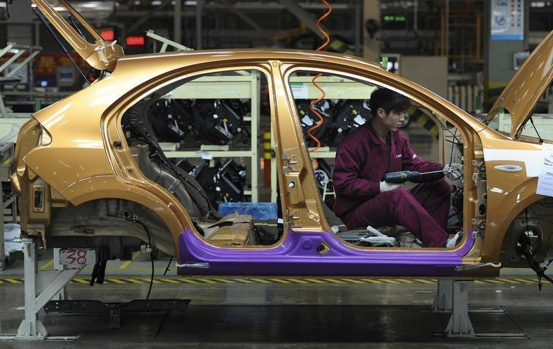 An employee works at a production line of an automobile factory in Hefei