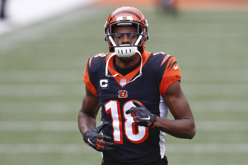 FILE - In this Sunday, Jan. 3, 2021 file photo, Cincinnati Bengals wide receiver A.J. Green (18) warms up before an NFL football game against the Baltimore Ravens in Cincinnati. The Arizona Cardinals made a pair of big offseason moves, adding seven-time Pro Bowl receiver A.J. Green on a one-year deal and trading for three-time Pro Bowl center Rodney Hudson. (AP Photo/Aaron Doster, File)
