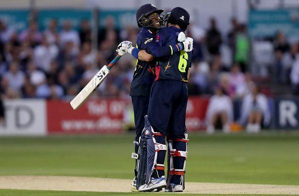 Daniel Bell-Drummond and Joe Denly celebrate scoring a world record opening during the Essex v Kent game