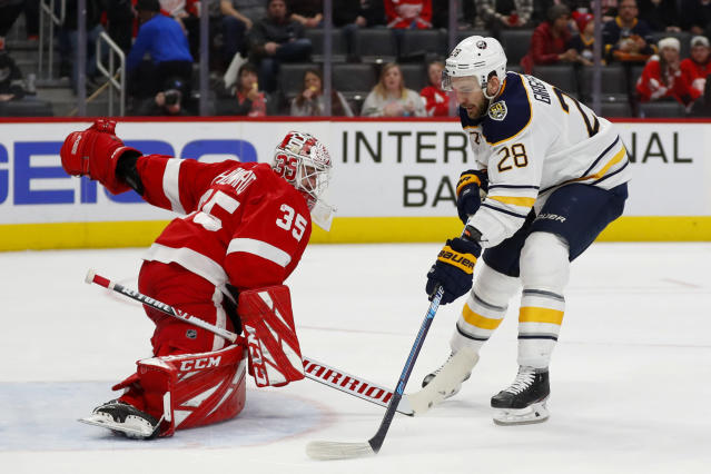 Buffalo Sabres center Zemgus Girgensons (28) scores on Detroit Red Wings goaltender Jimmy Howard (35) in the first period of an NHL hockey game Sunday, Jan. 12, 2020, in Detroit. (AP Photo/Paul Sancya)