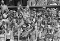 <p>A fan waves an item of underwear at Bjorn Borg on Centre Court at Wimbledon in June 1975.</p>