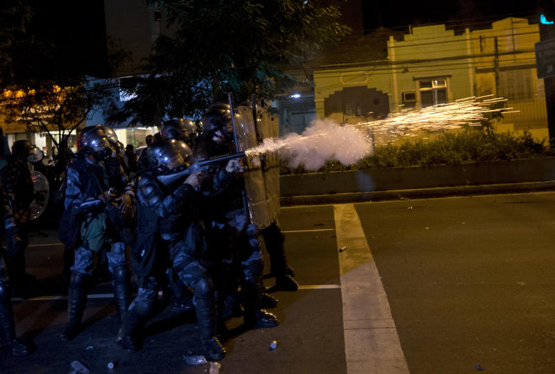 Brazilian police shot tear gas at demonstrators during an anti-government protest in Rio de Janeiro's sister city, Niteroi, Brazil, Wednesday evening, June 19, 2013. Rio de Janeiro and Sao Paulo city leaders said Wednesday that they reversed an increase in bus and subway fares that ignited anti-government protests. Many people doubted the move would quiet the demonstrations which have moved well beyond outrage over the fare hikes into communal cries against poor public services in Latin America's biggest nation. (AP Photo/Silvia Izquierdo)