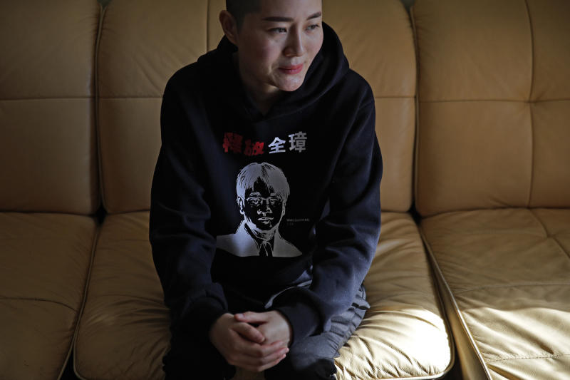 "FILE - In this Jan. 28, 2019, file photo, Li Wenzu, wife of prominent Chinese human rights lawyer Wang Quanzhang reacts after Wang's sentencing, at her house in Beijing. Wang was released from prison Sunday, April 5, 2020, after being held for more than four years, his wife said. Wang was among more than 200 lawyers and legal activists swept up in 2015 in what became known as the 709 Crackdown for the date, July 9, when most of them were detained. The sweater Li wears has print of her husband's portrait with the words ""Release Quanzhang."" (AP Photo/Andy Wong, File)"