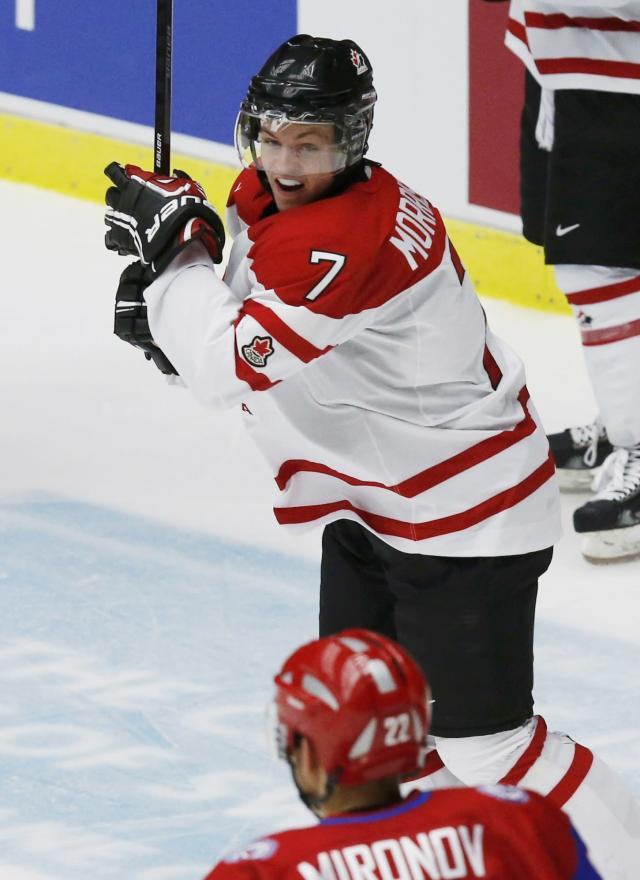 Canada's Josh Morrissey reacts after scoring against Russia during the third period of their IIHF World Junior Championship bronze medal ice hockey game in Malmo, Sweden, January 5, 2014. REUTERS/Alexander Demianchuk (SWEDEN - Tags: SPORT ICE HOCKEY)