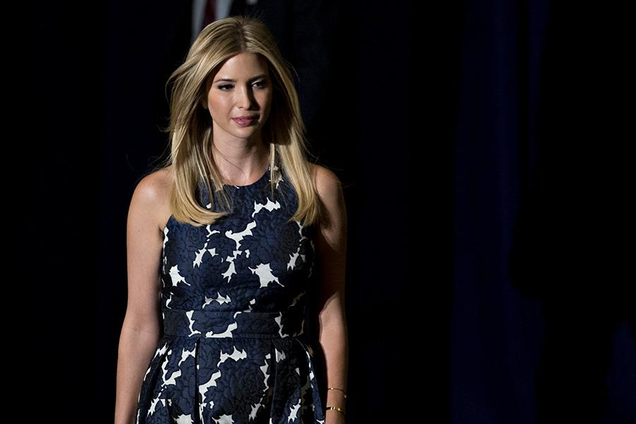 <p>To listen to her father speak at a campaign event in Virginia Beach, Virg. during the summer, Ivanka Trump wore a white dress adorned with navy blue flowers. (Photo: Getty Images) </p>