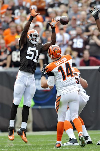 Cleveland Browns linebacker Barkevious Mingo (51) tips a pass from Cincinnati Bengals quarterback Andy Dalton (14) in the second quarter of an NFL football game on Sunday, Sept. 29, 2013, in Cleveland. The pass was eventually caught by Bengals tight end Tyler Eifert. (AP Photo/David Richard)