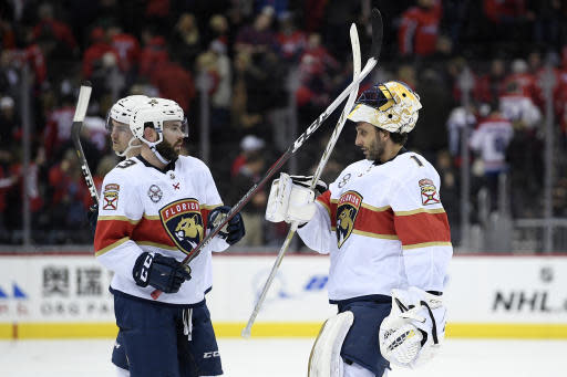 Florida Panthers goaltender Roberto Luongo (1) celebrates with defenseman Keith Yandle (3) after the team's NHL hockey game against the Washington Capitals, Saturday, Feb. 9, 2019, in Washington. The Panthers won 5-4 in overtime. (AP Photo/Nick Wass)