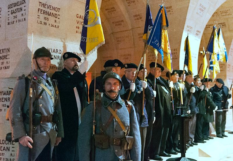 People wearing uniforms of the 56th and 59th light infantry battalions and standard-bearers pose during a ceremony marking the centenary of the beginning of the battle of Verdun at the Ossuary of Douaumont, eastern France, on February 21, 2016 (AFP Photo/Jean-Christophe Verhaegen)