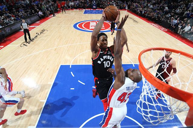 DeMar DeRozan goes over and through Anthony Tolliver, who was a kind man and will be missed. (Getty)