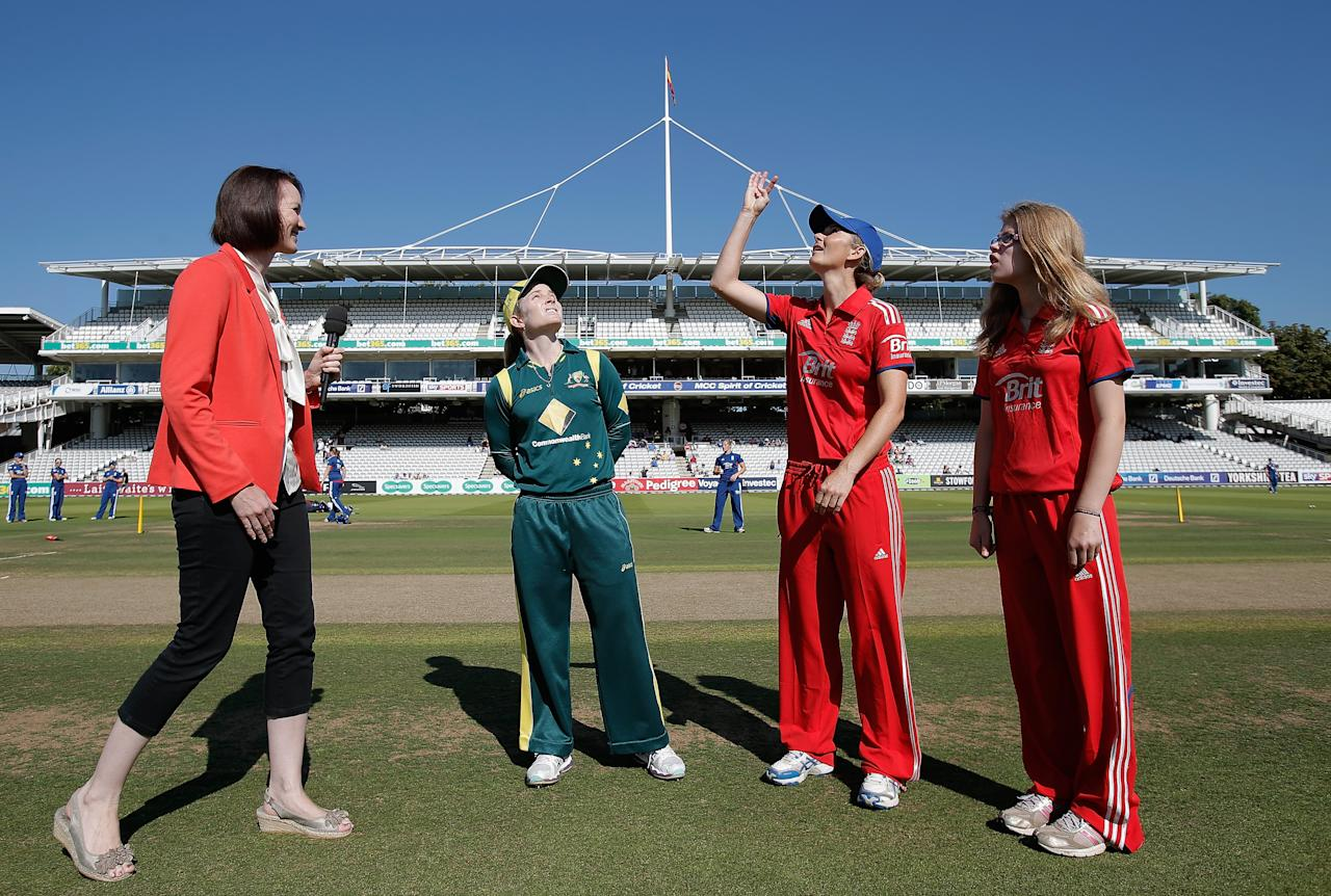 LONDON, ENGLAND - AUGUST 20: England captain Charlotte Edwards (2R) tosses the coin as Australia captain Jodie Fields (2L) looks on prior to the first NatWest One Day International match between England and Australia at Lord's Cricket Ground on August 20, 2013 in London, England.  (Photo by Harry Engels/Getty Images)