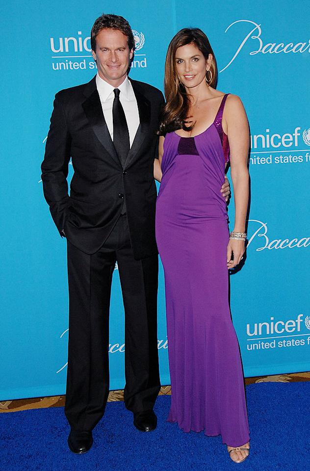 "Cindy Crawford, in a striking purple gown, and husband Rande Gerber joined their recent Mexican vacation buddies George Clooney and Elisabetta Canalis for the charity event. The evening raised more money for the organization than any UNICEF Ball to date. Jon Kopaloff/<a href=""http://www.filmmagic.com/"" target=""new"">FilmMagic.com</a> - December 10, 2009"
