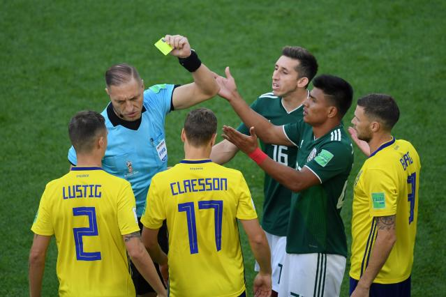 Mexico's defender Jesus Gallardo is shown a yellow card by Argentine referee Hernan Maidana during the Russia 2018 World Cup Group F football match between Mexico and Sweden at the Ekaterinburg Arena in Ekaterinburg on June 27, 2018. (Getty Images)