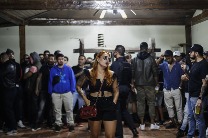 Police break up a social gathering during an operation against illegal and clandestine gatherings that authorities believe are partly responsible for fueling the spread of COVID-19, at a party hall in Sao Paulo, Brazil, early Saturday, April 17, 2021. (AP Photo/Marcelo Chello)