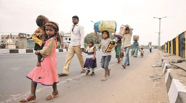 No transport and no money, migrants take long road home