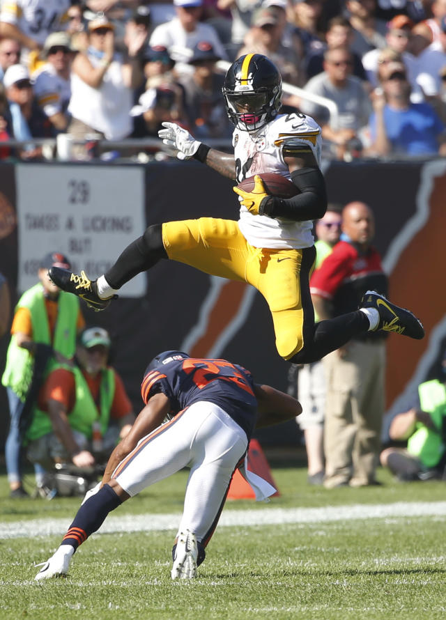 <p>Pittsburgh Steelers running back Le'Veon Bell (26) leaps over Chicago Bears cornerback Kyle Fuller (23) during the second half of an NFL football game, Sunday, Sept. 24, 2017, in Chicago. (AP Photo/Charles Rex Arbogast) </p>