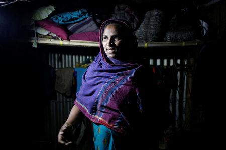 Rohingya Muslim refugee Sanmaraz describes her story in front of Reuters TV camera inside her room in the Leda Unregistered Refugee Camp in Teknaf, Bangladesh