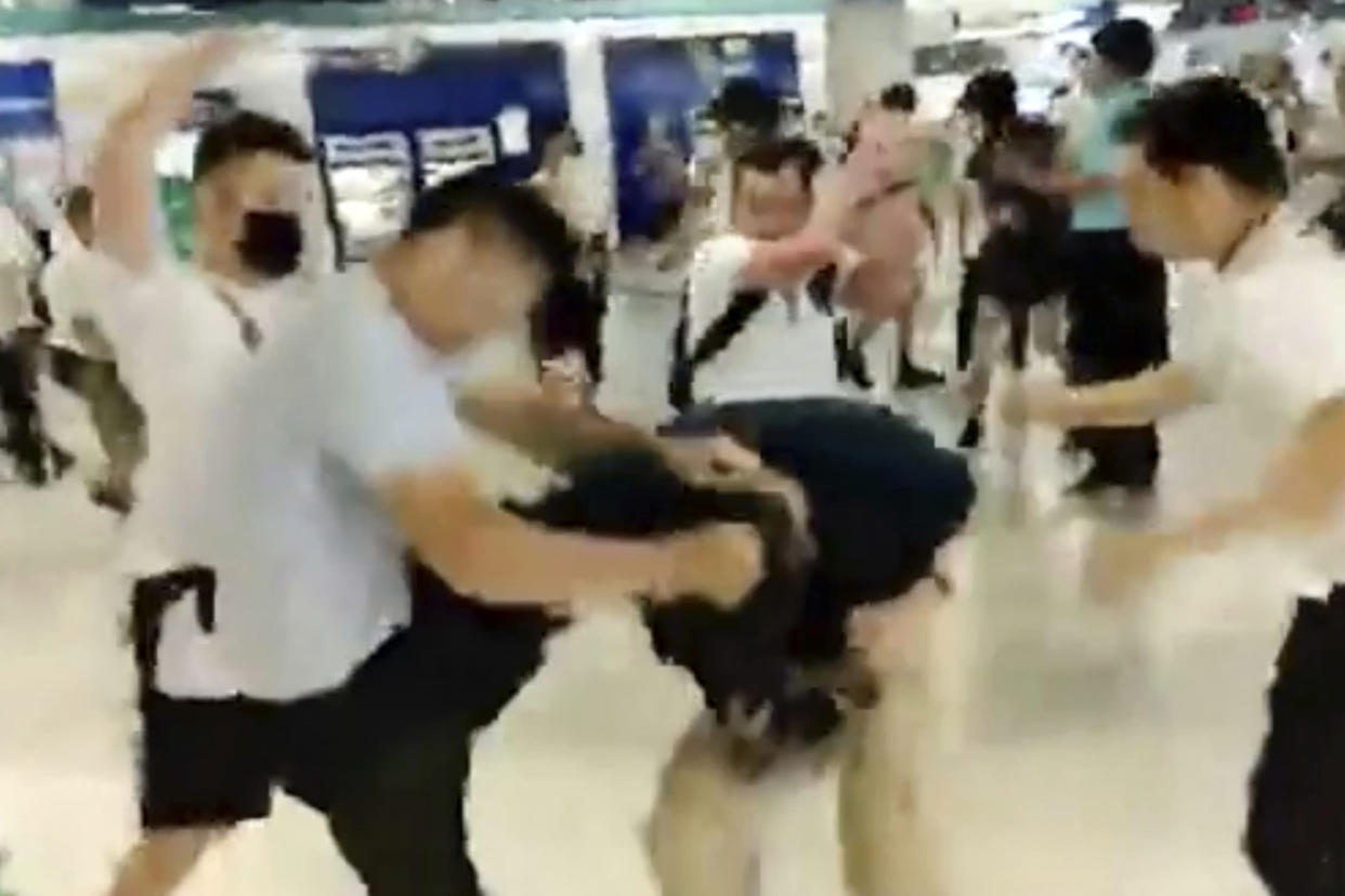 In this image taken from a video footage run by The Stand News via AP Video, white shirted men attacked a man dressed in black shirt at a subway station in Hong Kong on July 21, 2019. | Anonymous—AP