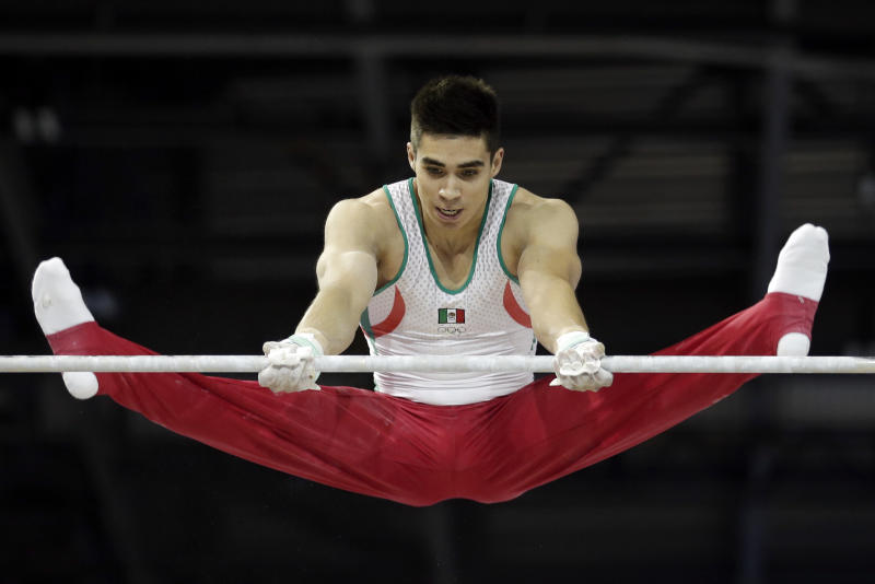 Mexico's Daniel Corral performs on the horizontal bar during artistic gymnastics all-around competition in the Pan Am Games in Toronto, Monday, July 13, 2015. (AP Photo/Gregory Bull)
