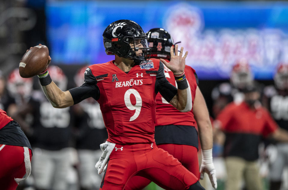 ATLANTA, GA - JANUARY 01: Desmond Ridder #9 of the Cincinnati Bearcats with the ball during a game against the Georgia Bulldogs at Mercedes-Benz Stadium on January 1, 2021 in Atlanta, Georgia. (Photo by Benjamin Solomon/Getty Images)