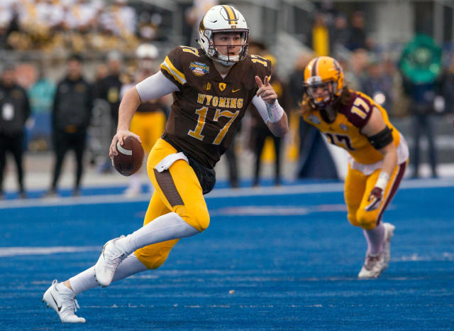 FILE - In this Dec. 22, 2017, file photo, Wyoming quarterback Josh Allen (17) runs with the ball against Central Michigan during the Famous Idaho Potato Bowl NCAA college football game, in Boise, Idaho. Four quarterbacks are certain to go in the first round of the NFL draft. (Darin Oswald/Idaho Statesman via AP, File)