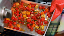 """<p><strong>Recipe: </strong><a href=""""https://www.southernliving.com/recipes/oven-roasted-tomato-sauce"""" rel=""""nofollow noopener"""" target=""""_blank"""" data-ylk=""""slk:Oven-Roasted Tomato Sauce"""" class=""""link rapid-noclick-resp""""><strong>Oven-Roasted Tomato Sauce</strong></a></p> <p>There are too many ways to use these oven-roasted cherry tomatoes to even count. </p>"""