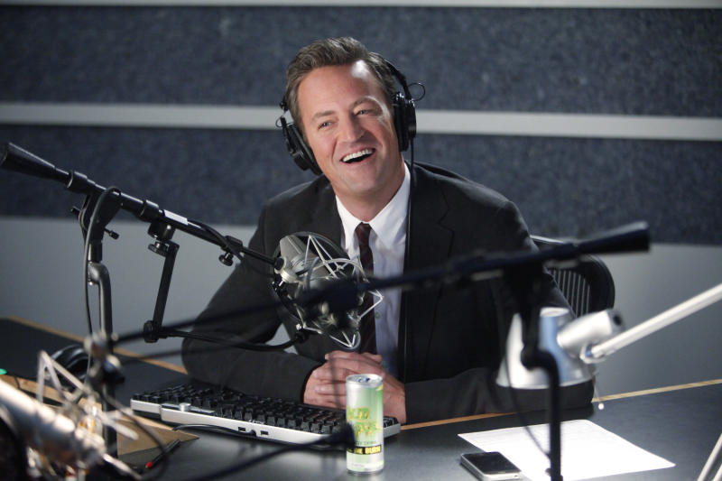 """This undated image released by NBC shows Matthew Perry portraying Ryan King in the pilot episode of """"Go On."""" Sneak peeks of NBC's new prime-time schedule will piggyback on network coverage of the 2012 Summer Olympic Games. The unveiling will begin with commercial-free sneak previews of NBC's new comedies """"Go On"""" on Aug. 8, after the evening's Olympics coverage, and of """"Animal Practice"""" on Aug. 12, following the Olympics' Closing Ceremonies. (AP Photo/NBC, Jordin Althaus)"""