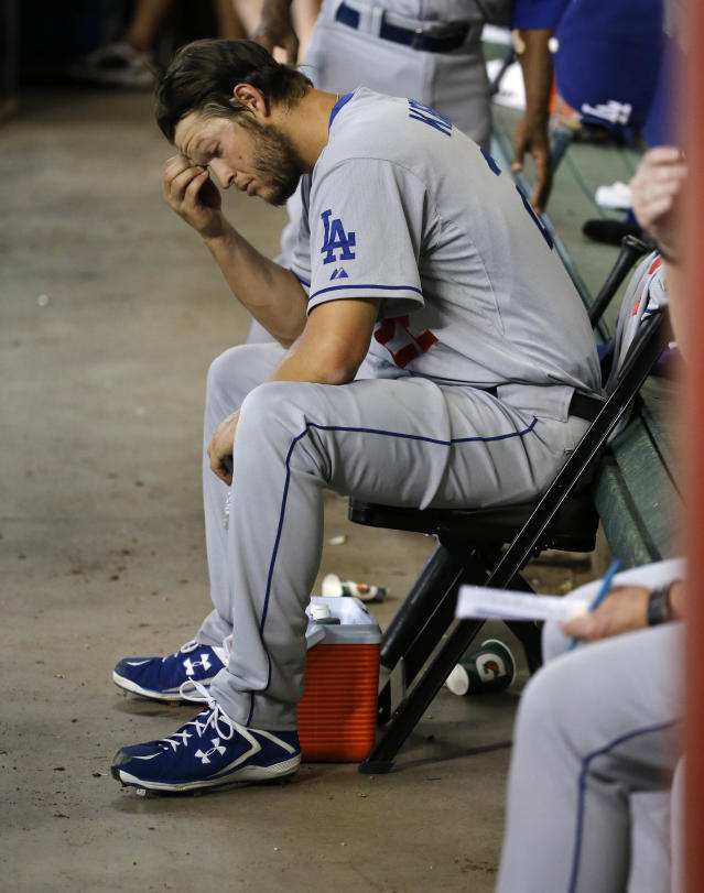Los Angeles Dodgers pitcher Clayton Kershaw sits in the dugout after being pulled from the baseball game during the second inning against the Arizona Diamondbacks on Saturday, May 17, 2014, in Phoenix. (AP Photo/Matt York)