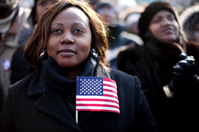 Large crowds watch the inauguration of Barack Obama as the 44th president of the United States on a large screen in the neighborhood of Harlem January 20, 2009 in New York City. (Photo by Rick Gershon/Getty Images)