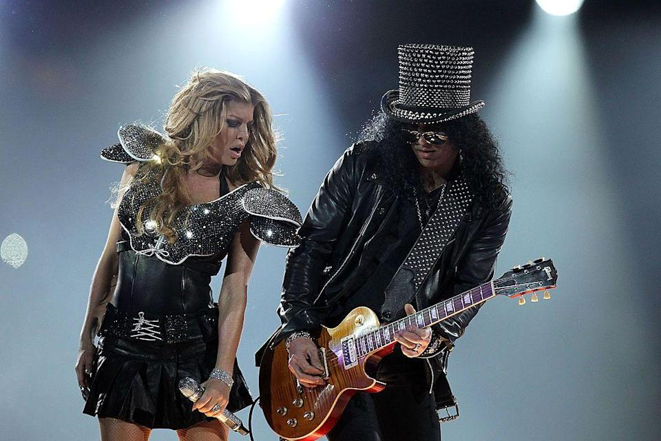 <p>Slash joined them on stage with a signature studded top hat.</p>