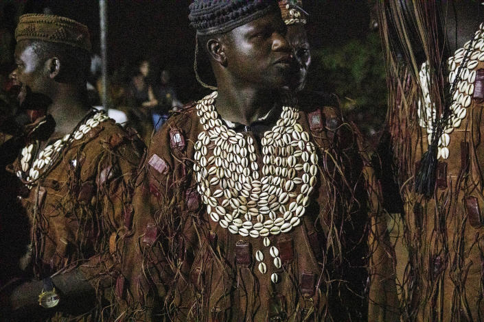 Dozos, ancient hunters who have been drawn into the Islamic extremist fight, participate in a celebration of their culture in Bobo-Dioulasso, Burkina Faso, 360 kilometers (220 miles) west of the capital, Ouagadougou, on Sunday, March 28, 2021. Dozos believe people can rely on powers from their ancestors. Spiritual protections can be granted so long as someone is a good person, believes in the process and undergoes an initiation. (AP Photo/Sophie Garcia)