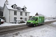 A delivery van drives through snow in Braco, near Dunblane in Scotland. (Photo by Andrew Milligan/PA Images via Getty Images)