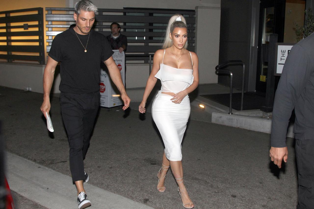 <p>Kim was recently spotted out in Bel Air wearing a slinky and slightly see-through 90s number from Helmut Lang's latest collection. <em>[Photo: Splash]</em> </p>