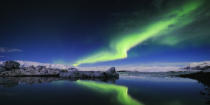 <p>Iceland secured the top spot – and this is the Northern Lights dazzling on a clear night (Picture:REX) </p>
