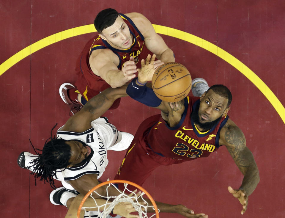 LeBron James goes up and grabs the rebound. He's gotten a few of those over his 15-year career. (AP)