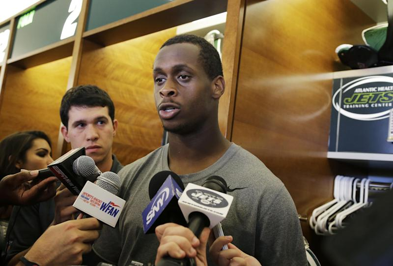New York Jets quarterback Geno Smith (7) answers a question after football practice in Florham Park, N.J. Wednesday, Sept. 4, 2013. (AP Photo/Mel Evans)